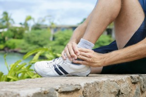 Runner nursing an ankle sprain